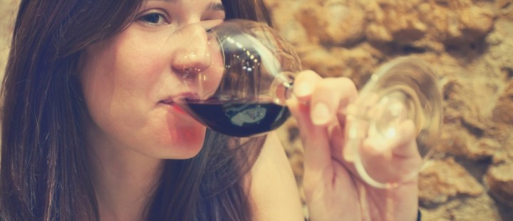 Pretty woman drinking wine